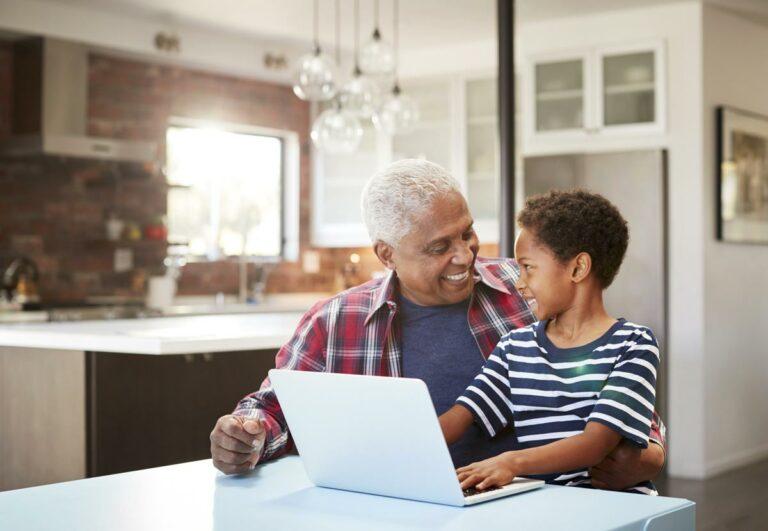 The Philomena   Senior using computer with grandson