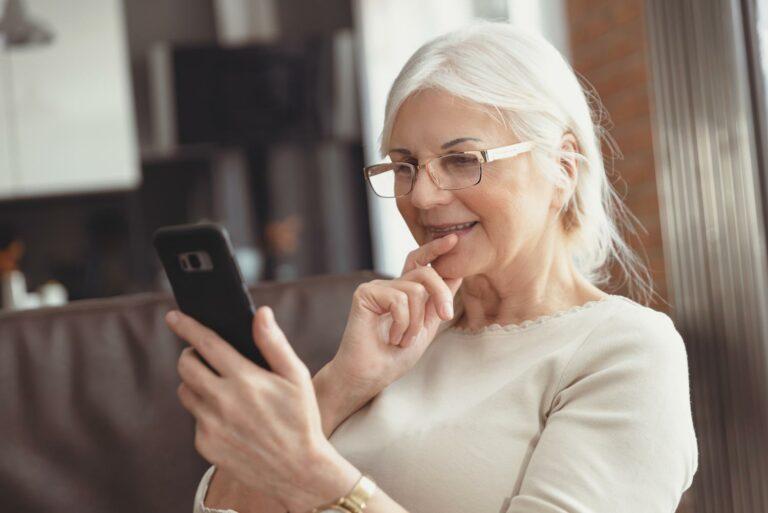 The Philomena | Seniors woman looking at smartphone