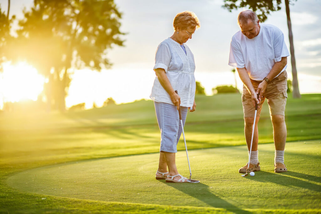 The Philomena   Seniors practicing their putting on the putting green